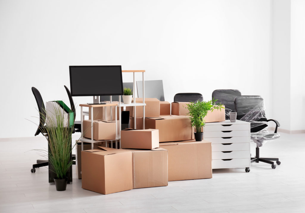 Carton boxes and packed office furniture before an office relocation